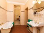 Adjoining bathroom with all soaps and shampoos