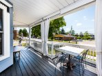 The covered porch offers sitting, lounge and dining areas.