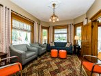 Formal parlor with plenty of comfy upholstered furnishings for gathering and entertaining.