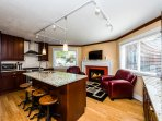 The spacious kitchen offers professional grade s/s appliances set off gorgeous cherry cabinetry.