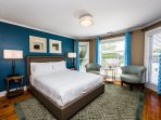 Bedroom suite 5 with attached private bath, upholstered furnishings and luxury bedding.