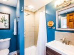Bedroom 5 ensuite bath offers our luxury multi-head shower tower, towels and other guest amenities.