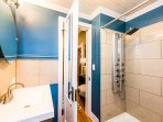 Bedroom 2 private ensuite bath features our luxury multi-head shower, quality towels and amenities.