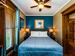 Bedroom suite 1 with private ensuite bath, comfortable furnishings, ceiling fan and TV.