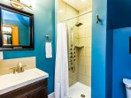 Bedroom 1 private ensuite bath with our luxury multi-head shower tower, quality towels & amenities.