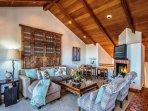 Beautiful vaulted beamed ceilings throughout the top floor.