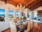 Dining area adjacent to the kitchen with full bay views.