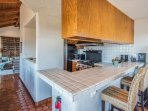 Fully equipped gourmet kitchen with breakfast bar.