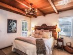 Comfortable and luxurious Master Bedroom with balcony on left and ocean views on right.