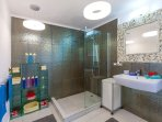 Modern shower for your comfort.It is next to your Master bedroom.