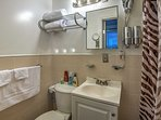 After a busy day, clean up in this bathroom's shower/tub combo.