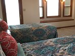 The master bedroom overlooks the back yard and a couple hundred acres of farm ground.