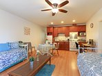 The apartment has an open layout for the dining, living room and the kitchen area.