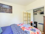 The bedroom is furnished with comfortable queen and singles beds
