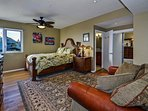 Beautifully appointed and over sized master bedroom with Tommy Bahama furnishings and top of the line bedding, with...