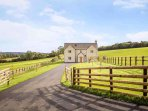 An impressive Cotswold stone farmhouse, on the edge of the famous market town of Stow-on-the-Wold
