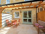 Courtyard garden with covered glass area and table & chairs - perfect for al-fresco dining.
