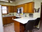 Another Kitchen View With Bar Stools