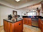 Kitchen has granite counter tops and stainless steel appliances.
