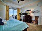 Master bedroom has a flat screen TV and balcony access.