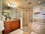 Separate his/hers vanities and walk in shower.