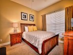 Guest room 1 has queen bed, flat screen TV and attached full bathroom.
