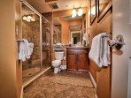 Guest room 1 bathroom has walk in shower.