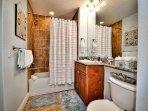 Guest room 2 bathroom has tub / shower combination.