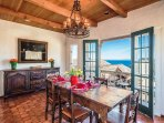 Dining Room with beautiful table settings and Monterey Bay views.