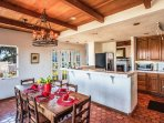 Chefs Dream Kitchen with 2 sets of French Doors and Ocean Views.