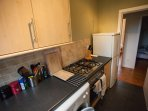 Fully equipped kitchen with washing machine, stove, oven, fridge/freezer