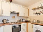 Well equipped kitchen and washer/dryer