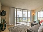 Floor-to-ceiling windows offer plenty of natural light and sweeping views of the surrounding cityscape.