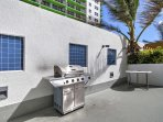 This stunning resort terrace features a swimming pool, hot tub and grilling area.