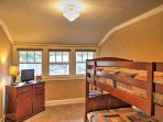 This room is ideal for kids, boasting a small TV and twin-over-twin bunk bed.