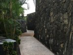 Lava rock wall on path to street