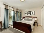 In the queen bedroom there are floor to ceiling windows to let in the warm sun and provide a beautiful view of the...
