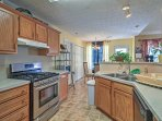 With natural wood elements, stainless steal appliances, and ample counter space, the fully equipped kitchen is every...