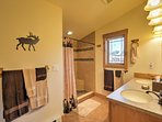 Prepare for the day ahead in this spacious en-suite bathroom.