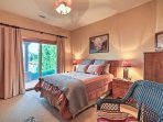 This bedroom offers a queen bed and access to the patio.