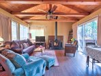 Vaulted ceilings with exposed wood draw your attention as you enter the living room.