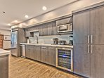 Newly Renovated Gourmet Kitchen with New Stainless Steel Appliances, a Large Island, Quartz Countertops and a Wine...