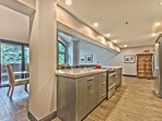 Gourmet Kitchen with New Stainless Steel Appliances, Quartz Countertops and a Wine Fridge