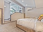 Spacious Master Bedroom with King Bed, A/C Wall Unit, a Full Private Bath and Sitting Areas