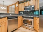 Fully equipped kitchen with plenty of counter space and stainless Frigidaire appliances.