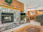 Open living space with flat screen TV/DVD and wood burning fireplace. A great place for gathering with friends and...