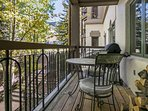 Cozy deck with seating for two and gas grill.  The deck faces east with views of the Highlands lift (Lift 2) and tennis...