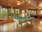 Full spacious game room with pool table, foosball, arcade and Playstation 4.