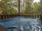 Entry level deck hot tub surrounded by trees