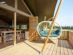 Open two sets of bi-folding doors onto the deck.  Sway in the swinging sofa.